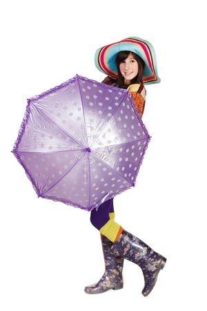 Beautiful girl with umbrella isolated on white photo