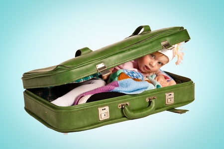 Beautiful little girl in suitcase isolated on white photo