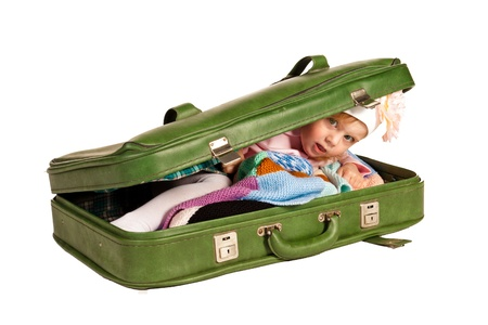 Beautiful little girl in suitcase isolated on white 版權商用圖片