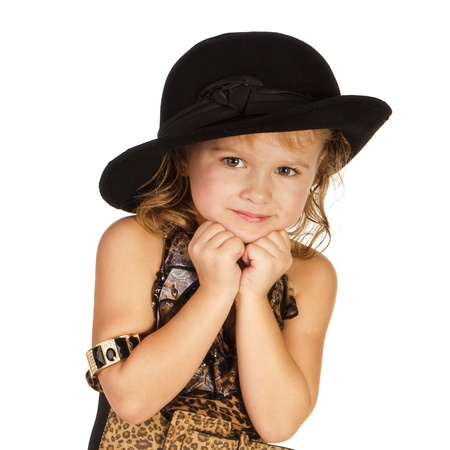 Beautiful little girl in a hat over white background photo