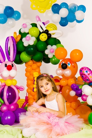 Beautiful little girl in balloon forest with balloon flower Stock Photo