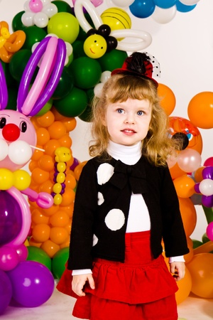 Beautiful little girl in balloon forest with balloon flower Stock Photo - 13031793