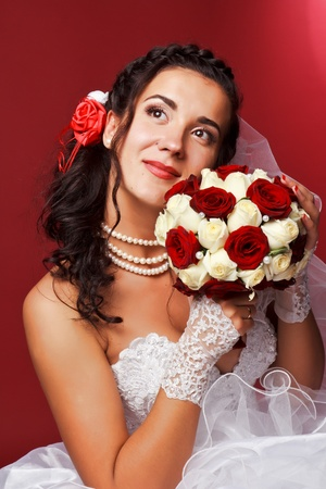 Portrait of a beautiful happy bride in studio photo
