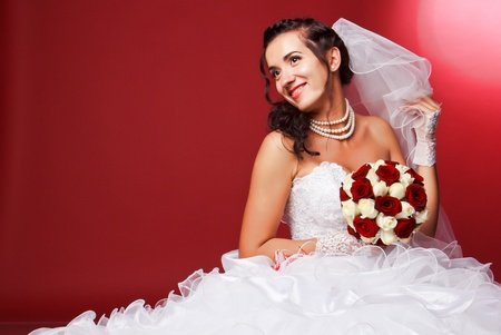 Portrait of a beautiful happy bride in studio