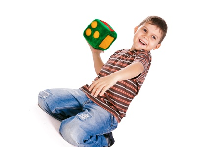 Happy kids throughing block with numbers over white background photo
