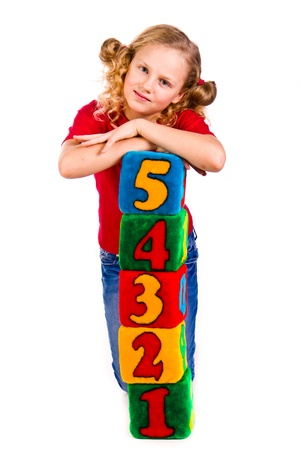 Happy girl holding blocks with numbers over white background Stock Photo - 13272356