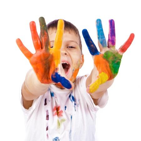 Little boy with hands painted in colorful paints ready for hand prints over white background