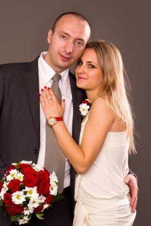 Happy bride and groom in studio Stock Photo - 13646417