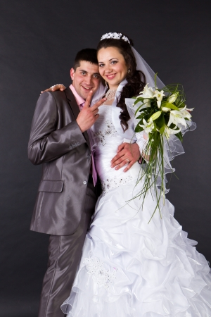 Happy bride and groom in studio photo