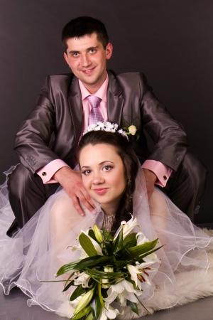 Happy bride and groom in studio Stock Photo - 13666201
