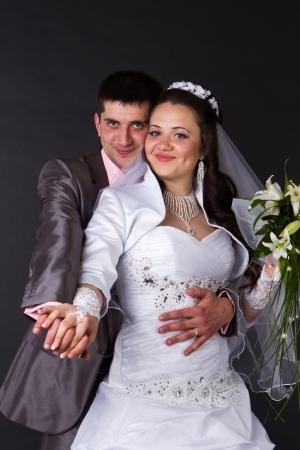 Happy bride and groom in studio photo