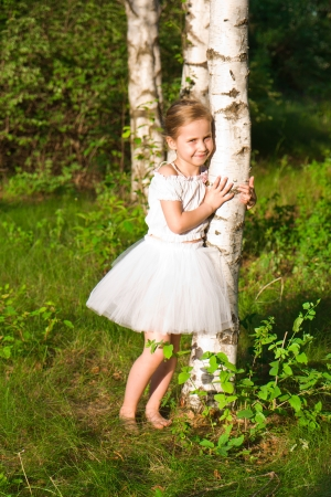Beautiful girl in the forest near birch outdoor photo