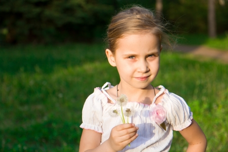 Beautiful girl in the forest with dandelion outdoor photo
