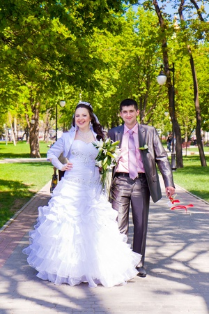 Happy bride and groom with bouquet outdoor Stock Photo - 13855651