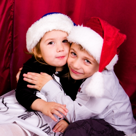 Cute boy and girl in Santa photo