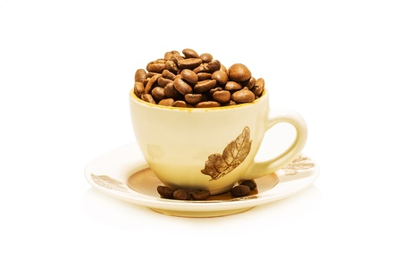 Coffe cup with coffe beans isolated on white photo