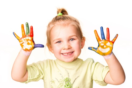 Portrait of a happy cheerful girl showing her hands painted in bright colors, isolated over white Stock Photo - 17444795