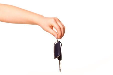 Male hand holding a car key isolated on white  New car concept photo