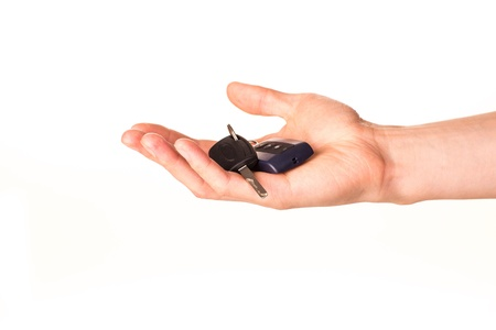 Male hand holding a car key isolated on white  New car concept Stock Photo - 17499139