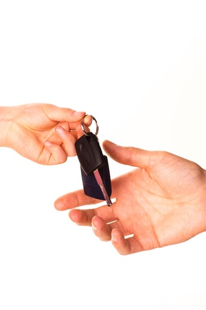 Male hand holding a car key and handing it over to another person isolated Reklamní fotografie - 17499158