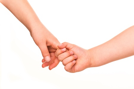 Two kids holding hands together isolated on white  Concept of support, assistance