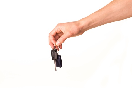 Male hand holding a car key isolated on white  New car concept Stock Photo - 17499143