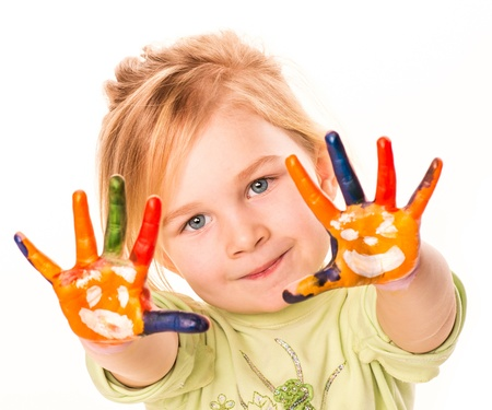 Portrait of a happy cheerful girl showing her hands painted in bright colors, isolated over white
