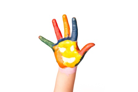 hand colored: Colored hand with smile painted in colorful paints as logo  Isolated on white background
