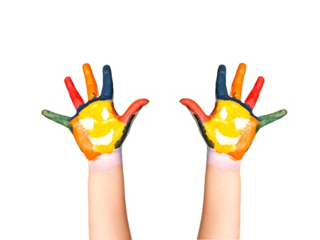 The two colorful hands with smile painted with different colors of child as logo  Isolated on white background Reklamní fotografie - 17499160