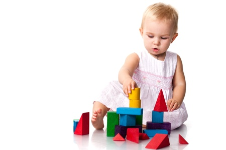 yellow block: Beautiful baby building a castle with cubes isolated on white