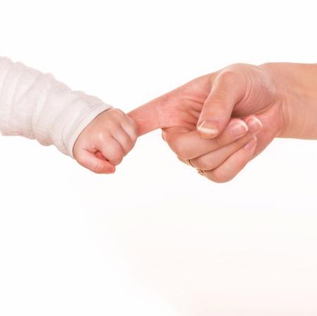 Baby holds mother Reklamní fotografie