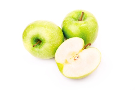 Fresh green apples isolated on white photo
