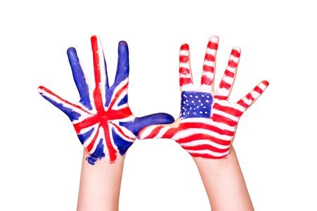 American and English flags on hands. Learning English language concept. photo
