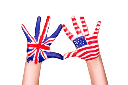 english language: American and English flags on hands. Learning English language concept. Stock Photo
