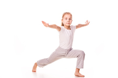 Beautiful girl gymnast  exercising, stretching isolated on white photo