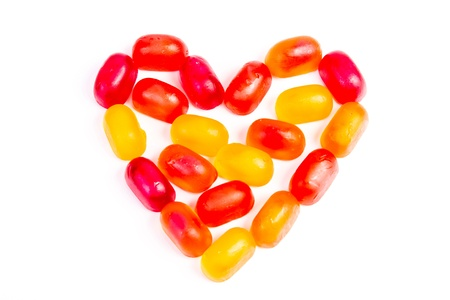 Colorful jelly candy love note in shape of heart isolated on white photo