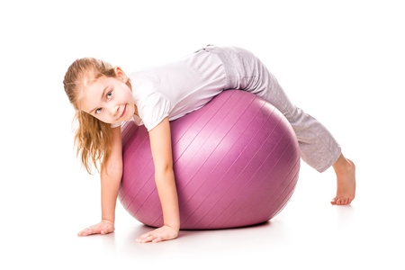 Sportive girl on a fit ball jumping isolated on white Stock Photo