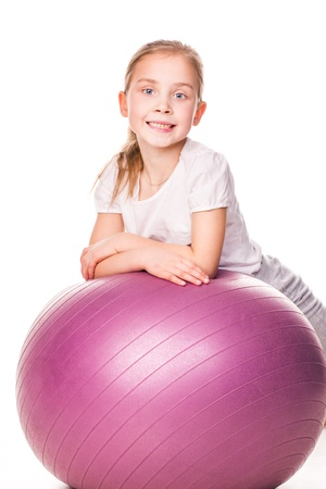 Sportive girl on a fit ball jumping isolated on white Stock Photo - 17893433