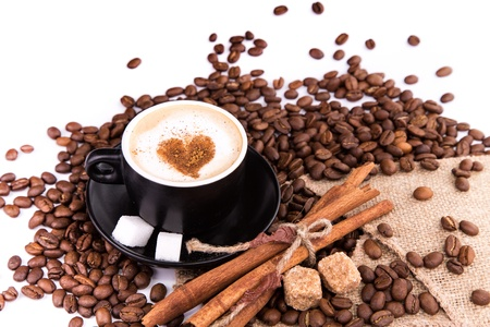 coffee grains: Coffee with coffee beans, cinnamon sticks, white and brown sugar isolated on white