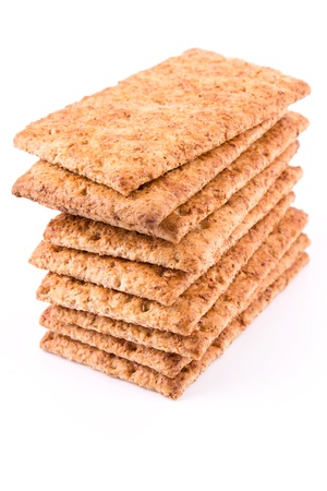 wholesome: Wholesome biscuits with cereal isolated on white. Healthy diet concept. Stock Photo