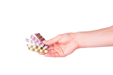 blasters: Male hand giving medical pills in blasters isolated on white  Stock Photo
