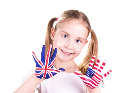 American and English flags on child's hands. Learning English language concept. Reklamní fotografie - 18204067