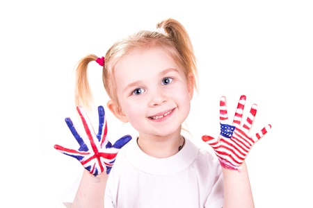 American and English flags on childs hands. Learning English language concept. Stock Photo