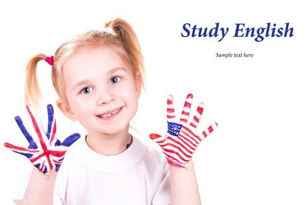 idiomas: Banderas estadounidenses e Ingl�s en las manos de los ni�os s Aprendizaje concepto idioma Ingl�s Foto de archivo