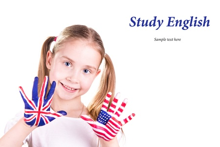 American and English flags on child s hands  Learning English language concept  Stock Photo