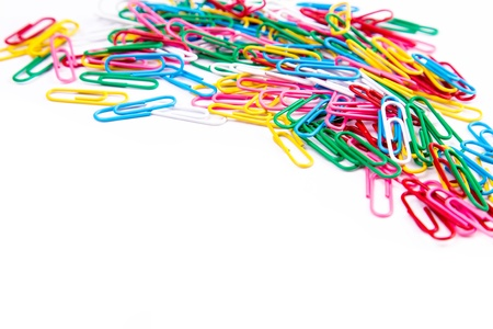 Multicolored paper clips isolated on white background with copy space for your sample text