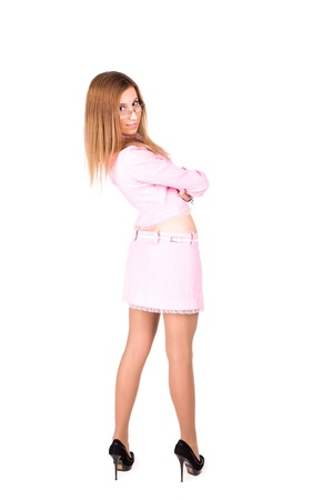 Beautiful business girl in a pink suit in glasses poingint out something isolated on white photo