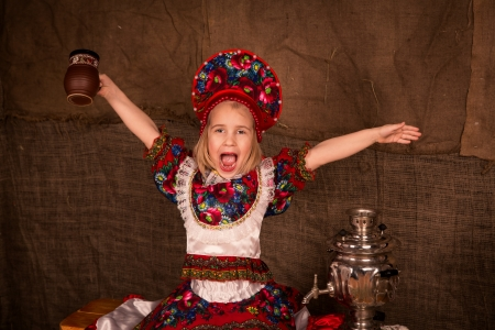 Beautiful russian girl ready to eat pancakes photo