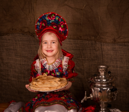Beautiful russian girl  with full plate of pancakes ready to eat pancakes photo