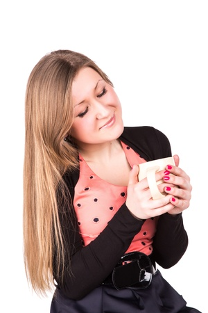 Beautiful business woman drinking hot cup of coffee isolated on white photo